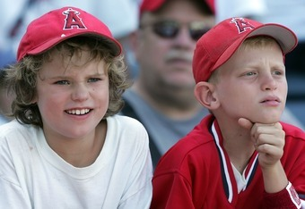 ANAHEIM, CA - JULY 24:  Two Los Angeles Angels of Anaheim fans look on before the game against the Oakland Athletics at Angels Stadium on July 24, 2007 in Anaheim, California.  (Photo by Lisa Blumenfeld/Getty Images)