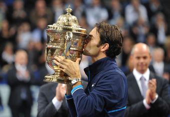BASEL, SWITZERLAND - NOVEMBER 06:  Roger Federer of Switzerland kisses the trophy as he celebrates victory after defeating Kei Nishikori of Japan during the final on day seven of the Swiss Indoors at St Jakobshalle on November 6, 2011 in Basel, Switzerlan