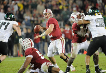 STANFORD, CA - NOVEMBER 12: Andrew Luck #12 of the Stanford Cardinal drops back to pass against the Oregon Ducks at Stanford Stadium on November 12, 2011 in Stanford, California.  (Photo by Thearon W. Henderson/Getty Images)