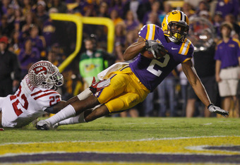 BATON ROUGE, LA - NOVEMBER 12:  Rueben Randle #2 of the Louisiana State University Tigers falls to the one yard line after being tackled by Tyree Robinson #22 of the Western Kentucky Hilltoppers at Tiger Stadium on November 12, 2011 in Baton Rouge, Louisi