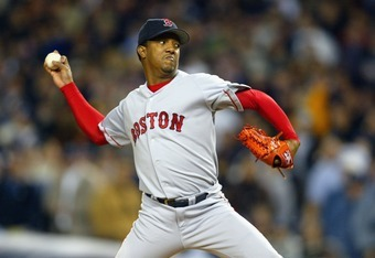 BRONX, NY - OCTOBER 16:  Starting pitcher Pedro Martinez #45 of the Boston Red Sox pitches during game 7 of the American League Championship Series against the New York Yankees on October 16, 2003 at Yankee Stadium in the Bronx, New York. The Yankees won
