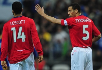 PARIS - MARCH 26:  Captain Rio Ferdinand of England talks to Joleon Lescott during the International Friendly match between France and England at the Stade de France on March 26, 2008 in Paris, France.  (Photo by Shaun Botterill/Getty Images)