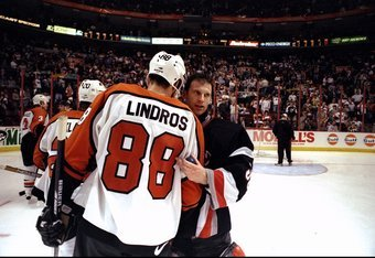 1 May 1998:  Goaltender Dominik Hasek of the Buffalo Sabres in action against center Eric Lindros of the Philadelphia Flyers during the NHL Playoffs round 1 game 5 at the Corestates Complex in Philadelphia, Pennsylvania. The Sabres defeated the Flyers 3-2