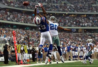 ARLINGTON, TX - NOVEMBER 13:   Alan Ball #20 of the Dallas Cowboys defends  Donald Jones #19 of the Buffalo Bills at Cowboys Stadium on November 13, 2011 in Arlington, Texas.  (Photo by Ronald Martinez/Getty Images)