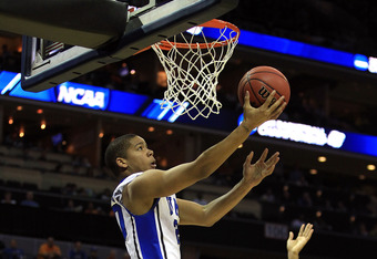 CHARLOTTE, NC - MARCH 18:  Andre Dawkins #20 of the Duke Blue Devils lays the ball up while taking on the Hampton Pirates in the second half during the second round of the 2011 NCAA men's basketball tournament at Time Warner Cable Arena on March 18, 2011