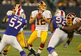 TORONTO, ON - OCTOBER 30:  John Beck #12 of the Washington Redskins looks to pass against the Buffalo Bills at Rogers Centre on October 30, 2011 in Toronto, Ontario, Canada. Buffalo won 23-0.  (Photo by Rick Stewart/Getty Images)