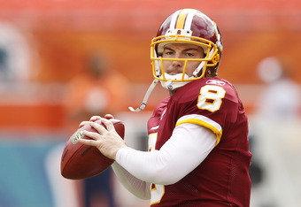 MIAMI, FL - NOVEMBER 13: Rex Grossman #8 of the Washington Redskins throws the ball prior to the game against the Miami Dolphins on November 13, 2011 at Sun Life Stadium in Miami, Florida. (Photo by Joel Auerbach/Getty Images)