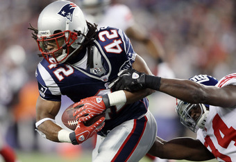 FOXBORO, MA - NOVEMBER 06:   BenJarvus Green-Ellis #42 of the New England Patriots carries the ball as  Mathias Kiwanuka #94 of the New York Giants defends on November 6, 2011 at Gillette Stadium in Foxboro, Massachusetts.  (Photo by Elsa/Getty Images)