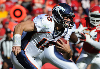KANSAS CITY, MO - NOVEMBER 13:  Quarterback Tim Tebow #15 of the Denver Broncos rushes to the outside against the Kansas City Chiefs on November 13, 2011 during the first half at Arrowhead Stadium in Kansas City, Missouri.  (Photo by Peter Aiken/Getty Ima