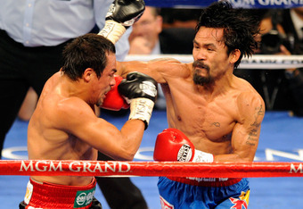 A Pac-Man right hook finds the jaw of Marquez