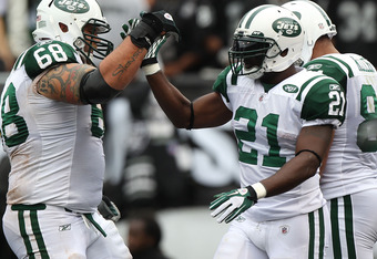OAKLAND, CA - SEPTEMBER 25:  LaDainian Tomlinson #21 of the New York Jets celebrates with Matt Slauson #68 after a touchdown against the Oakland Raiders at O.co Coliseum on September 25, 2011 in Oakland, California.  (Photo by Jed Jacobsohn/Getty Images)