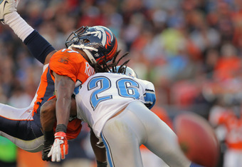 DENVER, CO - OCTOBER 30:  Wide receiver Eddie Royal #19 of the Denver Broncos is hit by Louis Delmas #26 of the Detroit Lions as he was unable to receive a pass from quarterback Tim Tebow at Sports Authority at Invesco Field at Mile High on October 30, 20