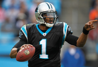 CHARLOTTE, NC - NOVEMBER 13:   Cam Newton #1 of the Carolina Panthers points down field during their game against the Tennessee Titans at Bank of America Stadium on November 13, 2011 in Charlotte, North Carolina.  (Photo by Streeter Lecka/Getty Images)