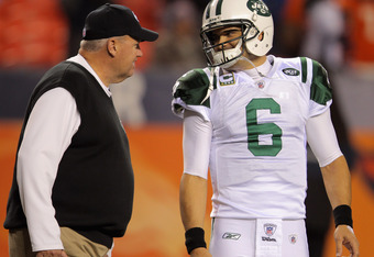 DENVER, CO - NOVEMBER 17:  Head coach Rex Ryan and Mark Sanchez #6 of the New York Jets talk on the field prior to playing against the Denver Broncos at Invesco Field at Mile High on November 17, 2011 in Denver, Colorado.  (Photo by Doug Pensinger/Getty I