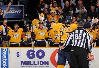 NASHVILLE, TN - NOVEMBER 17:  Fans and players react to Brian McGrattan of the Nashville Predators after a fight against a member of the Toronto Maple Leafs of the  at Bridgestone Arena on November 17, 2011 in Nashville, Tennessee.  (Photo by Frederick Br