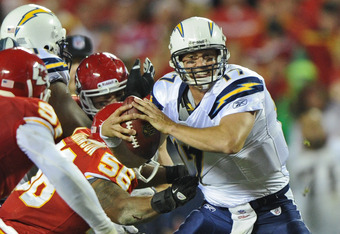 KANSAS CITY, MO - OCTOBER 31:  Quarterback Philip Rivers #17 of the San Diego Chargers gets sacked during the second quarter against the Kansas City Chiefs on October 31, 2011 at Arrowhead Stadium in Kansas City, Missouri.  (Photo by Peter Aiken/Getty Ima
