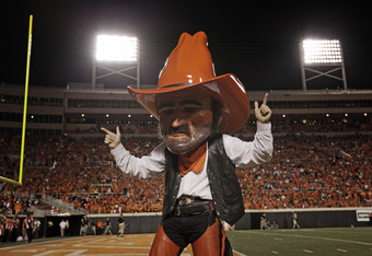 STILLWATER, OK - SEPTEMBER 8:  Oklahoma State Cowboys mascot Pistol Pete performs during the game against the Arizona Wildcats on September 8, 2011 at Boone Pickens Stadium in Stillwater, Oklahoma.  Oklahoma State defeated Arizona 37-14.  (Photo by Brett