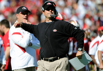 SAN FRANCISCO, CA - OCTOBER 30:  Head coach Jim Harbaugh of the San Francisco 49ers challanges a call against the Cleveland Browns at Candlestick Park on October 30, 2011 in San Francisco, California.  (Photo by Thearon W. Henderson/Getty Images)