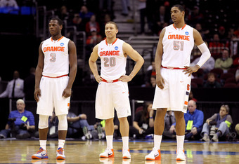 CLEVELAND, OH - MARCH 18: Dion Waiters #3, Brandon Triche #20 and Fab Melo #51 of the Syracuse Orange look on late in the game against the Indiana State Sycamores during the second round of the 2011 NCAA men's basketball tournament at Quicken Loans Arena