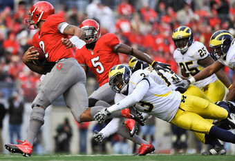 COLUMBUS, OH - NOVEMBER 27:  Marvin Robinson #3 of the Michigan Wolverines lunges to attempt a tackle on Terrelle Pryor #2 of the Ohio State Buckeyes at Ohio Stadium on November 27, 2010 in Columbus, Ohio.  (Photo by Jamie Sabau/Getty Images)