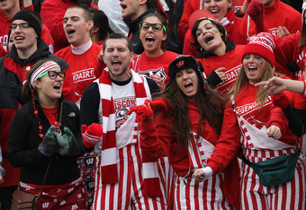 CHAMPAIGN, IL - NOVEMBER 19: Fansi of the Wisconsin Badgers sing during a game against the Illinois Fightin Illini at Memorial Stadium on November 19, 2011 in Champaign, Illinois. Wisconsin defeated Illinois 28-17. (Photo by Jonathan Daniel/Getty Images)