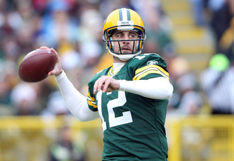GREEN BAY, WI - NOVEMBER 20:  Aaron Rodgers #12 of the Green Bay Packers looks to pass in the first quarter against the Tampa Bay Buccaneers on November 20,2011 at Lambeau Field in Green Bay, Wisconsin.  (Photo by Elsa/Getty Images)