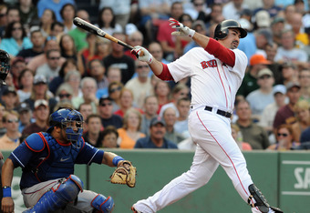 BOSTON, MA - SEPTEMBER 03: Adrian Gonzalez #28 of the Boston Red Sox swings at a pitch as catcher Yorvid Torrealba #8 of the Texas Rangers looks on in the third inning at Fenway Park on September 3, 2011 in Boston, Massachusetts. The Boston Red Sox won th