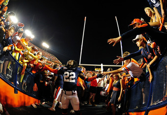 AUBURN, AL - OCTOBER 15: T'Sharvan Bell #22 of the Auburn Tigers celebrates with fans after the game against the Florida Gators at Jordan-Hare Stadium on October 15, 2011 in Auburn, Alabama. Photo by Scott Cunningham/Getty Images)