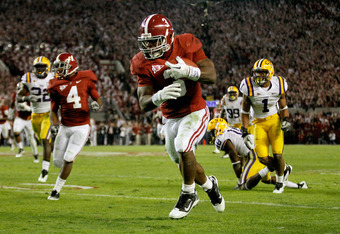 TUSCALOOSA, AL - NOVEMBER 05:  Trent Richardson #3 of the Alabama Crimson Tide runs with the ball during the first half of the game against the LSU Tigers at Bryant-Denny Stadium on November 5, 2011 in Tuscaloosa, Alabama.  (Photo by Streeter Lecka/Getty