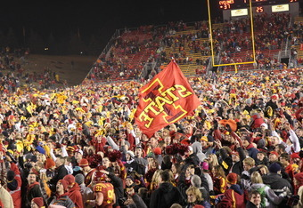 AMES, IA - NOVEMBER 18:  Iowa State Cyclones fans rush the field after an upset win against the Oklahoma State Cowboys at Jack Trice Stadium November 18, 2011 in Ames, Iowa.  (Photo by Reese Strickland/Getty Images)