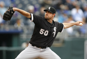 KANSAS CITY, MO - SEPTEMBER 18:   Starting pitcher John Danks #50 of the Chicago White Sox throws in the second inning during a game against the Kansas City Royals at Kauffman Stadium on September 18, 2011 in Kansas City, Missouri. (Photo by Ed Zurga/Gett