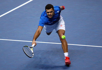 LONDON, ENGLAND - NOVEMBER 22:  Jo-Wilfried Tsonga of France returns the ball during the men's singles round match against Mardy Fish of USA during the Barclays ATP World Tour Finals at the O2 Arena on November 22, 2011 in London, England.  (Photo by Cliv