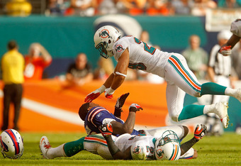 MIAMI GARDENS, FL - NOVEMBER 20:  Steve Johnson #13 of the Buffalo Bills loses his helmet as he has a pass knocked away by  Vontae Davis #21 and Tyrone Culver #29 of the Miami Dolphins during a game  at Sun Life Stadium on November 20, 2011 in Miami Garde