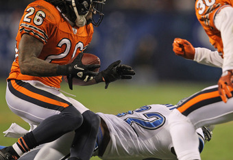 CHICAGO, IL - NOVEMBER 13: Tim Jennings #26 of the Chicago Bears intercepts a pass over Rashied Davis #82 of the Detroit Lions at Soldier Field on November 13, 2011 in Chicago, Illinois. The Bears defeated the Lions 37-13. (Photo by Jonathan Daniel/Getty