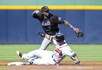 ATLANTA, GA - SEPTEMBER 17: Martin Prado #14 of the Atlanta Braves slides into second as Jose Reyes #7 of the New York Mets hesitates on a double play throw in the first inning of the game at Turner Field on September 17, 2011 in Atlanta, Georgia. The Bra