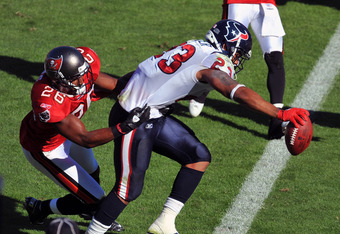 TAMPA, FL - NOVEMBER 13: Running back Arian Foster #23 of the Houston Texans stretches across the goal line for a touchdown against the Tampa Bay Buccaneers November 13, 2011 at Raymond James Stadium in Tampa, Florida. (Photo by Al Messerschmidt/Getty Ima