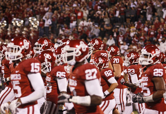 NORMAN, OK - OCTOBER 22:  The Oklahoma Sooners take the field after a 1 hour and 30 minute rain delay against the Texas Tech Red Raiders on October 22, 2011 at Gaylord Family-Oklahoma Memorial Stadium in Norman, Oklahoma. Texas Tech upset Oklahoma 41-38.