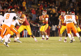 AMES, IA - NOVEMBER 18:  Jared Barnett #16 of the Iowa State Cyclones looks to pass against the Oklahoma State Cowboys at Jack Trice Stadium November 18, 2011 in Ames, Iowa.  (Photo by Reese Strickland/Getty Images)