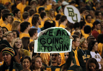 WACO, TX - NOVEMBER 19:  Baylor Bears students cheer during a 48-35 win against the Oklahoma Sooners at Floyd Casey Stadium on November 19, 2011 in Waco, Texas.  (Photo by Ronald Martinez/Getty Images)