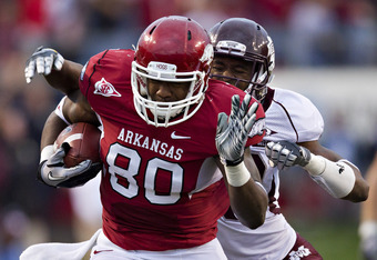 LITTLE ROCK, AR - NOVEMBER 19:   Chris Gragg #80 of the Arkansas Razorbacks runs the ball after catching a pass against the Mississippi State Bulldogs at War Memorial Stadium on November 19, 2011 in Little Rock, Arkansas.  (Photo by Wesley Hitt/Getty Imag