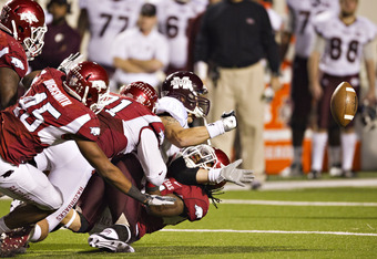 LITTLE ROCK, AR - NOVEMBER 19:   Jake Bequette #91 and Jerico Nelson #31 of the Arkansas Razorbacks sack and cause a fumble by Dylan Favre #6 of the Mississippi State Bulldogs at War Memorial Stadium on November 19, 2011 in Little Rock, Arkansas.  The Raz