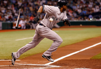 ST. PETERSBURG, FL - SEPTEMBER 28:  Eduardo Nunez #26 of the New York Yankees attempts a bunt against the Tampa Bay Rays during the game at Tropicana Field on September 28, 2011 in St. Petersburg, Florida.  (Photo by J. Meric/Getty Images)