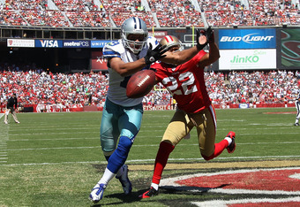 SAN FRANCISCO, CA - SEPTEMBER 18:   Miles Austin #19 of the Dallas Cowboys misses a pass against Carlos Rogers #22 of the San Francisco 49ers at Candlestick Park on September 18, 2011 in San Francisco, California.  (Photo by Jed Jacobsohn/Getty Images)