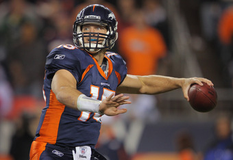 DENVER, CO - NOVEMBER 17:  Quarterback Tim Tebow #15 of the Denver Broncos drops back to pass against the New York Jets at Sports Authority Field at Mile High on November 17, 2011 in Denver, Colorado. The Broncos defeated the Jets 17-13.  (Photo by Doug P