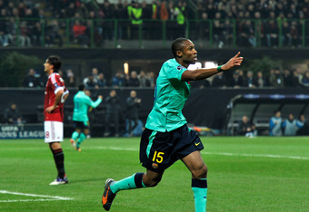 MILAN, ITALY - NOVEMBER 23:  Seydou Keita of FC Barcelona celebrates after the first goal during the UEFA Champions League group H match between AC Milan and FC Barcelona at Giuseppe Meazza Stadium on November 23, 2011 in Milan, Italy.  (Photo by Claudio
