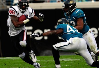 JACKSONVILLE, FL - DECEMBER 06:  Andre Johnson #80 of the Houston Texnas attempts to run against Gerald Alexander #42 and Daryl Smith #52 of the Jacksonville Jaguars during the game at Jacksonville Municipal Stadium on December 6, 2009 in Jacksonville, Fl