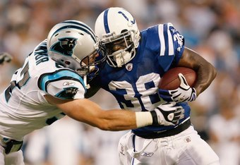 CHARLOTTE, NC - AUGUST 09:  Dominic Rhodes #38 of the Indianapolis Colts carries the ball as he is grabbed during the game against the Carolina Panthers at Bank of America Stadium on August, 9, 2008 in Charlotte, North Carolina.  (Photo by Kevin C. Cox/Ge