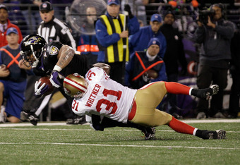 BALTIMORE, MD - NOVEMBER 24:  Ray Rice #27 of the Baltimore Ravens is tackled by Donte Whitner #31 of the San Francisco 49ers during the first half at M&T Bank Stadium on November 24, 2011 in Baltimore, Maryland.  (Photo by Rob Carr/Getty Images)