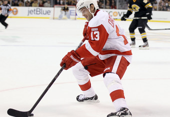 BOSTON, MA - NOVEMBER 25:  Pavel Datsyuk #13 of the Detroit Red Wings takes the puck in the first period against the Boston Bruins on November 25, 2011 at TD Garden in Boston, Massachusetts.  (Photo by Elsa/Getty Images)