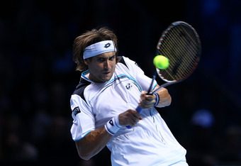LONDON, ENGLAND - NOVEMBER 26:  David Ferrer of Spain serves the ball during the men's singles semi-final match against Roger Federer of Switzerland  during the Barclays ATP World Tour Finals at the O2 Arena on November 26, 2011 in London, England.  (Phot
